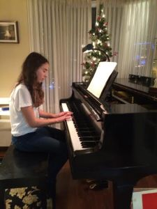 McKennah playing Christmas Carol