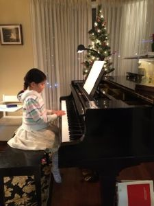 Vanessa playing Christmas Carol
